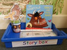 A story box full of the gruffalo activities,books,laminated puppets and soft toys.