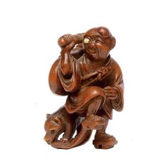 A Wood Netsuke Signed Ittokusai, Edo Period (19th century) Of a figure of a blind musician and his dog, eyes inlaid in ivory and cowhorn