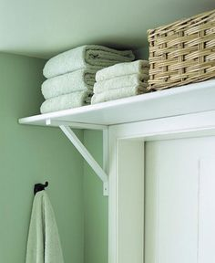 Bathroom idea - space-saving shelf over the door