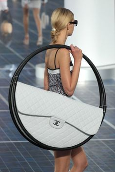 Chanel beach bag . . . I dont think I would carry this around lol
