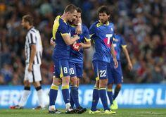 Alessandro Del Piero is embraced by Besart Berisha of the All Stars...