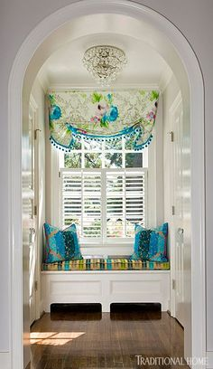 In a front arched alcove, a window seat was created above the radiator. - Traditional Home ® / Photo: Gordon Beall / Design: Kat Liebschwager