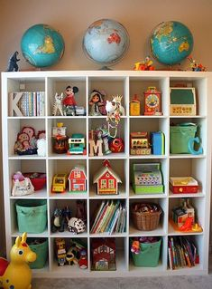 ***Toy Storage and a fun collection of vintage toys too! have the chalk lap desk, the barn and had bought one of the grandkids a vintage school house Cubbies, Toy Shelves, Cube Shelves, Ikea Shelves, Ideas Habitaciones, Deco Kids, Toy Storage, Storage Ideas, Playroom Storage