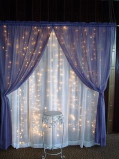 Curtain lights and sheer fabric would make a neat backdrop for a photo booth