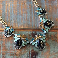 Statement Necklace This design features beautiful crystals in summer blues and pinks for a day to night look that will grab everyone's attention. Ocean Jewelers Jewelry