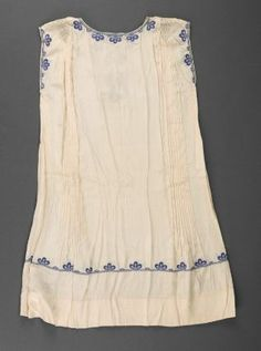Child's dress        American, 1920s     Dimensions      Center back: 73.7 cm (29 in.)  Medium or Technique      Silk plain weave with cotton embroidery  Classification      Costumes     Accession Number      2007.520  Not on view