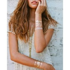 The perfect compliment to Criscara'sjewelry, these metallic temporary tattoos by Lulu DK are a must-have accessory for every wanderlust adventure! Easily apply them with water and remove with baby oil. They last 4-6 days. Each package contains 2 sheets of temporary metallic tattoos and includes silver and gold jewelry tattoos.Instructions are included. Made in the USA FINAL SALE - Not eligible for refund. - See more at…