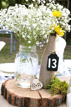 Elegant country wedding - table centerpieces (mason jar and twine-covered bottle vases)