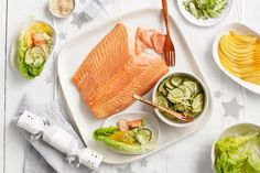 A side of salmon is briefly soaked in ginger and brown sugar brine, lending a silky texture and flavour to the salmon. The whole fillets are placed on baking paper and gently barbecued until rosy in the centre and glazed on the outside.