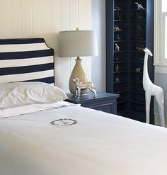 love the striped headboard with the navy furniture.