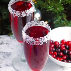 A cranberry lover's version of the standard mimosa. Tart cranberries pair perfectly with a sugar-rimmed glass and sparkling champagne bubbles!