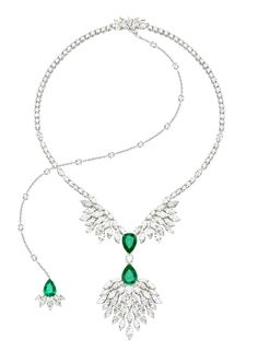 Necklace in 18K white gold set with 84 marquise-cut diamonds , 160 brilliant-cut diamonds , 3 pear-cut emeralds with a central stone and one brilliant-cut diamond.