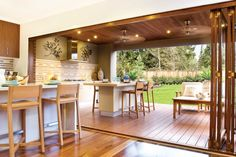 Love this. Stacking doors. Wooden deck and ceiling. Clean lines. Nice flow.