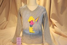 Hand painted, cotton fabric children's long sleeved tee, using non-toxic, water…