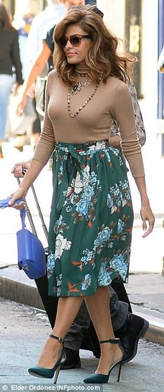 Showcase stunner: Eva Mendes modeled two pieces from her fashion line debut while in NYC on Wednesday, shortly after opening up about her home life with daughter Esmeralda and boyfriend Ryan Gosling