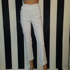"Lisette L Slim Ankle Pants White Size 8 NWOT This pair of Lisette L ankle pants flatten and flatter the stomach and thighs.  These are very chic and versatile.  They are wrinkle free and do not have bulky buttons and zippers.  28"" inseam.  76% rayon 20% nylon 4% lycra. Never worn. Lisette L Pants Ankle & Cropped"