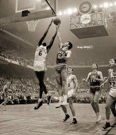 Bill Russell of the Boston Celtics grabs a rebound. Starting power forward