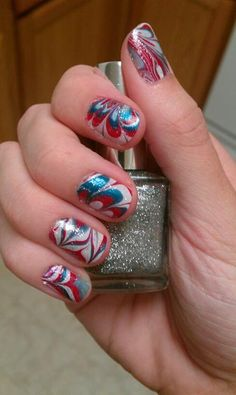 4th of July nails.  Red, white, blue nail marble with silver glitter on top.