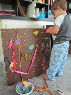 I NEED to find one of those geoboards for Tanner to play with.  I can see him being VERY entertained by this.