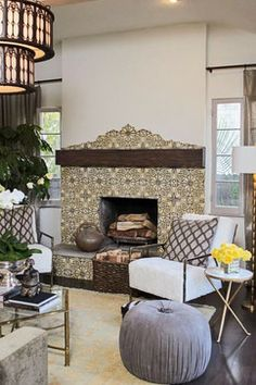 Traditional hand painted tile fireplace with rustic wood mantel. The modern furnishings blend the space with form and lines.
