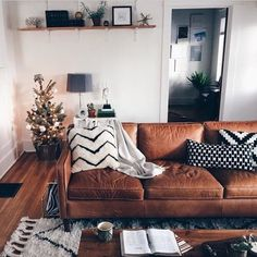leather couch + moroccan rug