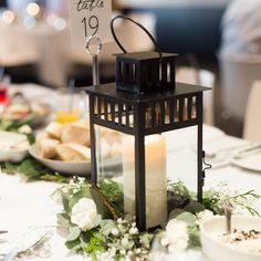 Black Metal Lanterns for Wedding Reception Table Centres and Decor.  Filled with candles or flowers, looks beautiful for a modern or even rustic wedding.   Available for Hire in Melbourne | Only $3.50  Also follow us on instagram @thesmallthingsco