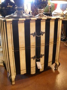 Painted chest. off white & black stripes with faux marbel top.