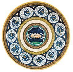 Plate with Fede Motif Emilia-Romagna, Faenza, ca. 1490–1510 Tin-glazed earthenware (maiolica); Diam. 11 1/4 in. (28.5 cm) Fondazione Cassa di Risparmio di Perugia (Wilson-Sani 20)