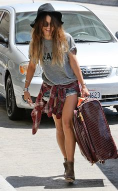 grey tee shirt with flannel around waist. fashionably casual