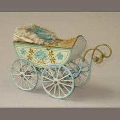 A fine tinplate miniature baby carriage, probably Marklin, circa 1909