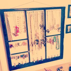 DIY Jewelry holder using an old frame with mesh stapled to it DIY