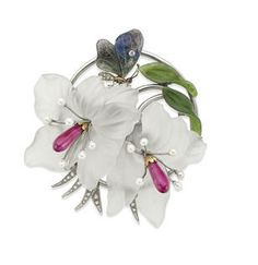 A mid 20th century gem-set brooch, by Kern, Vienna Formed as a spray of exotic lilies with carved rock crystal petals and cultured pearls and synthetic ruby stamens, the circular foliate border set with rose-cut diamonds and carved nephrite leaves, with a small diamond and carved labradorite butterfly resting on the petals, width 69mm, stamped '585', 'H.K' and signed 'KERN, WIEN', to original fitted case