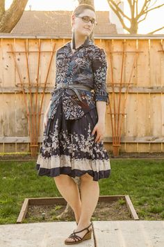 Pattern-mixing florals, tassel earrings, gray belt.