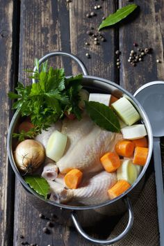 In a 6-quart sauce pot, combine a small whole chicken with:  Chicken neck  2 peeled carrots, cut into 2-inch pieces  1 stalk celery, cut into 2-inch pieces  1 yellow onion, cut into quarters  5 sprigs fresh parsley  1 clove garlic  1/2 teaspoon dried thyme  1/2 bay leaf