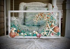This beach glass art, wall hanging would be a wonderful addition to any beach home! It depicts a wave made from tiny shell treasures. This wall hanging is framed in a simple white, wooden frame that measures about 21 x 11. The coastal frame hangs horizontally and has sawtooth hooks in the back, Beach Theme Bathroom, Beach Bathrooms, Bathroom Wall Art, Beach Cottage Decor, Coastal Decor, Coastal Living, Sea Glass Art, Glass Wall Art, Starfish Art