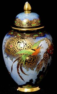 A Carlton Ware jar and cover of ovoid form, decorated in the Paradise Bird and Tree pattern on a mottled blue ground #ukauctioneers