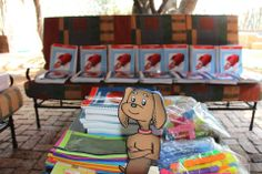 Up-Words Reading™ | Gus posing in front of the Up-Words Reading™ workbooks and resource materials in South Africa