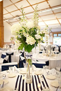 If I did go with the standard white table cloths with white napkins, I could add a runner down the middle of the table.