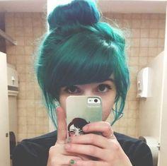 Green hair in a bun
