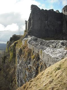 """If you travel to Wales, you must budget time into your itinerary for exploring some of the  many ruined castles that dot the Welsh countryside particularly Castell Carreg Cennen,(""""castle on the rock above the Cennen"""", in Welsh) , a spectacular Welsh castle located within Brecon Beacons National Park,Wales.   This 12th century stronghold of Rhys ap Gruffyddis dramatically located atop limestone cliffs overlooking the surrounding Welsh countryside, with spectacular views in all directions."""