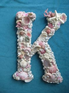 A pretty craft idea for kids - shells on their initial.  Find some colorful shells and ocean items.  This all pink and white is lovely.