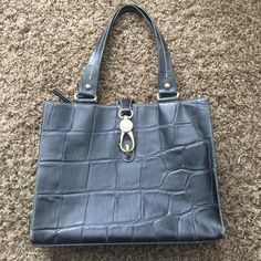 """Dooney & Bourke Authentic black (crocodile) purse Dooney & Bourke Authentic black leather (crocodile) purse.  Great condition with big inside zip pocket, small inside zip pocket & leather pocket. Measures 10"""" tall & 13"""" wide.  Bag included Dooney & Bourke Bags Totes"""