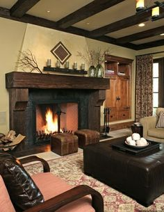 Spanish Revival Style- Wooden ceiling beams. These add a warm rustic appeal to this living space. This element is repeated in fireplace mantel.