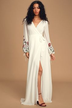 Turn heads in the Lulus My Angel White Embroidered Long Sleeve Wrap Maxi Dress! Lightweight woven poly wrap maxi dress with sheer, embroidered long sleeves. Long White Maxi Dress, White Wrap Dress, Maxi Wrap Dress, Long Sleeve Bridal Dresses, Sleeve Dresses, Bridal Gowns, Wedding Gowns, Casual Dresses For Teens, Max Dresses