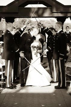 Military Wedding + swords + kiss