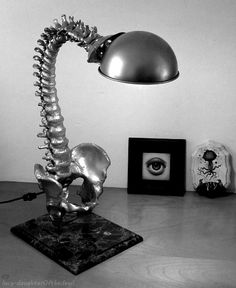 Spine reading lamp. Year-round decor for the Addams family and med students. Halloween for the rest of us.
