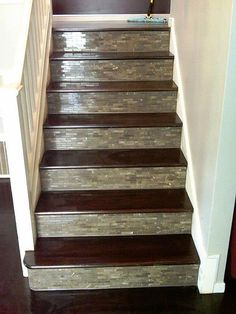 Dark Stair Treads, Tiled Risers, And A White Banister Make For A Great
