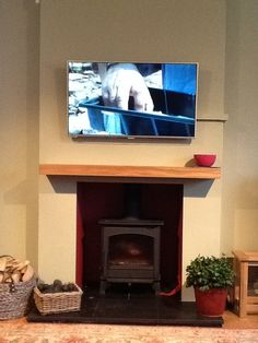 """check out this photo that Mr Quixley has sent in of his brand new floating oak mantel shelf. What do you think?"""