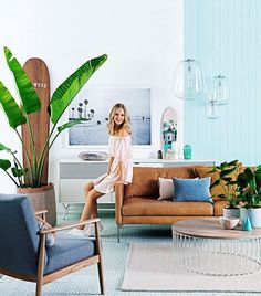 For a coastal look with a modern twist, anchor the room with a buttery tan leather sofa then layer with textural pieces in ocean hues.