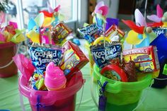 """Bellas 2nd Bday Party was a """"Summer/Beach Theme. These were the sand bucket favors I gave to each child, each filled with a juice, animal crackers, bubbles that looked like ice-cream, a frisbee, pin wheel, fun straws and more! So much fun to watch their faces."""